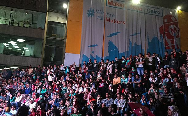 Participants at Maker Faire Cairo watching the Ibn Al-Haytham film.