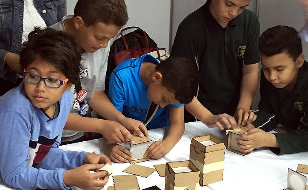 Children building camera Obscuras at the 1001 Inventions hands-on workshop.